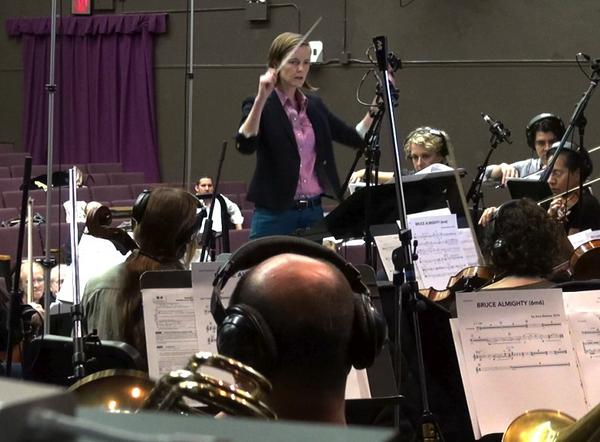 Amy conducting her score with the Orchestra at the Workshop